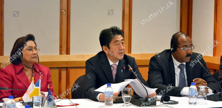 Japan's Prime Minister Shinzo Abe (c) Speaks Next to Prime Minister of Trinidad and Tobago Kamla Persad-bissessar (l) and the President of the Caribbean Community (caricom) and Prime Minister of Antigua and Barbuda Gaston Browne (r) During the Caribbean Community (caricom)/japan Summit at the Hilton Trinidad and Conference Centre Port-of-spain Trinidad and Tobago on 28 July 2014 Trinidad and Tobago Port-of-spain
