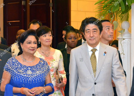 A Picture Available on 28 July 2014 Shows to Japanese Prime Minister Shinzo Abe (r) His Wife Akie Abe (c) and Trinidadian Prime Minister Kamla Persad-bissessar (l) Taking Part in a Welcoming Dinner in Port-of-spain Trinidad and Tobago 27 July 2014 Trinidad and Tobago Port-of-spain