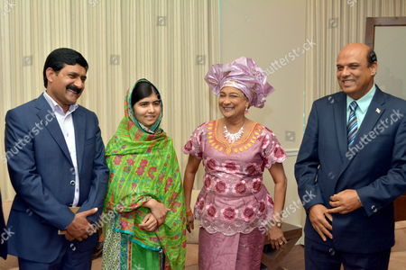 Pakistan's Children's Education Advocate Malala Yousafzai (2-l) Poses with Trinidad and Tobago's Prime Minister Kamla Persad-bissessar (2-r) During a Courtesy Call on the Prime Minister at the San Fernando Teaching Hospital on the Final Day of Her Visit to Trinidad and Tobago 31 July 2014 at Left is Her Father Ziauddin Yousafzai and at Right Tertiary Education Minister Fazal Karim who Invited Her to Trinidad Trinidad and Tobago Port-of-spain