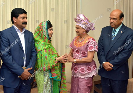 Pakistan's Children's Education Advocate Malala Yousafzai (2-l) Talks with Trinidad and Tobago's Prime Minister Kamla Persad-bissessar (2-r) During a Courtesy Call on the Prime Minister at the San Fernando Teaching Hospital on the Final Day of Her Visit to Trinidad and Tobago 31 July 2014 at Left is Her Father Ziauddin Yousafzai and at Right Tertiary Education Minister Fazal Karim who Invited Her to Trinidad Trinidad and Tobago Port-of-spain