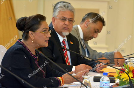 Stock Image of Prime Minister of Trinidad and Tobago Kamla Persad-bissessar (l) Speaks During a Bilateral Meeting with Venezuelan President Nicolas Maduro (not Pictured) at the Diplomatic Centre Port-of-spain Trinidad and Tobago on 24 February 2015 Next to Her is Minister of Planning Bhoe Tewarie (c) and Minister of Trade Vasant Bharath Trinidad and Tobago Port of Spain