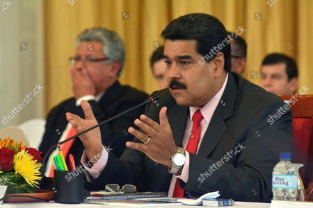 Venezuelan President Nicolas Maduro Speaks During a Bilateral Meeting with Prime Minister of Trinidad and Tobago Kamla Persad-bissessar (not in Picture) at the Diplomatic Centre Port-of-spain Trinidad and Tobago on 24 February 2015 Trinidad and Tobago Port of Spain