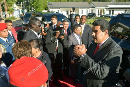 Stock Picture of Venezuelan President Nicolas Maduro (r) Leaves the Diplomatic Centre in Port-of-spain Trinidad and Tobago 24 February 2015 Maduro Concluded a One Day Visit to Trinidad and Tobago where He Met with Prime Minister of Trinidad and Tobago Kamla Persad-bissessar (not in Picture) Trinidad and Tobago Port of Spain