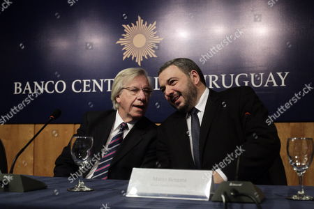 Stock Image of The Uruguayan Minister of Economy and Finance Danilo Astori (l) and the Newly Appointed President of the Central Bank of Uruguay (bcu) Are Seen at the Ceremony of the New Authorities of the Board of the Financial Instituion in Enrique V Iglesias Conference Room in Montevideo Uruguay 21 April 2015 Uruguay Montevideo