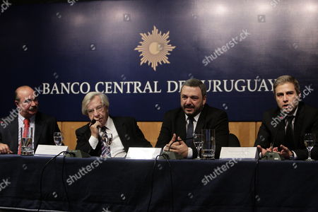 Stock Photo of The Newly Appointed President of the Central Bank of Uruguay (bcu) Mario Bergara (2-r) the Uruguayan Minister of Economy and Finance Danilo Astori (2-l) Alberto Grana (l) Outgoing President of the Bcu and Washington Ribeiro (r) the Outgoing Vicepresident Bcu During the Inauguration Ceremony of the New Authorities of the Directory of the Financial Institution in the Conference Room Enrique V Iglesias Bcu in Montevideo Uruguay 21 April 2015 Uruguay Montevideo