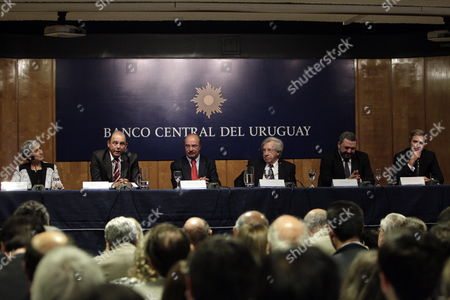 Stock Picture of From Left to Right the General Secretary of Central Bank of Uruguay (bcu) Elizabeth Oria the Newly Appointed Vicepresident of the Central Bank of Uruguay (bcu) Jorge Gamarra the Outgoing President of the Bcu Alberto Gra±a the the Uruguayan Minister of Economy and Finance Danilo Astori the Newly Appointed President of the Central Bank of Uruguay (bcu) Mario Bergara and the Outgoing Vicepresident of the Bcu Washington Ribeiro During the Inauguration Ceremony of the New Authorities of the Directory of the Financial Institution in the Conference Room Enrique V Iglesias Bcu in Montevideo Uruguay 21 April 2015 Uruguay Montevideo