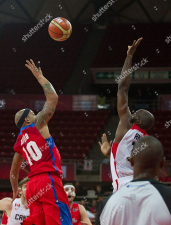 Puerto Rico's Player Larry Ayuso (l) Fights For the Ball Against Joel Anthony (r) of Canada During Their American World Cup Qualifications Tournament in Caracas Venezuela 31 August 2013 the World Cup Will Be Held in Spain in 2014 Venezuela Caracas