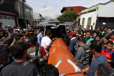 A Group of People Hold the Coffin of Late 14-year-old Kluiverth Roa During a Mass Held at San Cristobal Venezuela 25 February 2015 Venezuelan Prosecutors Have Reportedly Charged Javier Mora 23 a Policeman in Connection with the Death of a Roa who was Killed on 24 February During Protests Venezuela San Cristobal