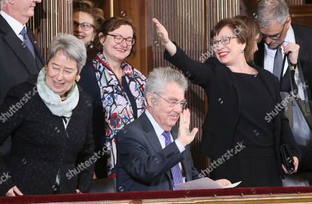 Former Austrian President Heinz Fischer, center, his wife Margit, left, and Alexander Van der Bellen's wife Doris Schmidauer, right, wave from the balcony before Van der Bellen is sworn in as Austria's president at the parliament in the Austrian capital Vienna