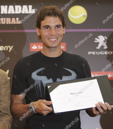 Spanish Tennis Player Rafael Nadal Poses For a Photograph with the Title of Honorable Visitor Given by the Mayor of Buenos Aires at a Press Conference in Buenos Aires Argentina 18 November 2013 Nadal Will Appear at Exhibition Matches with Argentinian David Nalbandian and Serbian Novak Djokovic Argentina Buenos Aires