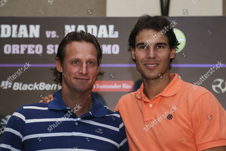 Spanish Tennis Player Number One in the Ranking Rafael Nadal (r) Poses with His Argentinean Colleague David Nalbandian (l) During a Press Conference in Cordoba City Argentina on 21 November 2013 Both Players Will Participate in This City in a Exhibition Match As a Farewell to Nalbandian Argentina C?rdoba
