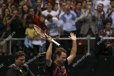 Argentinian David Nalbandian Reacts During a Match Against Spanish Rafael Nadal (not Pictured) During an Exhibition Game As Part of the Beggining of Nalbandian's Farewell From Tennis at the Orfeo Stadium in Cordoba Argentina 21 November 2013 Argentina Cordoba