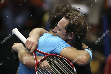 Spanish Tennis Player Rafael Nadal Hugs Argentinian David Nalbandian During an Exhibition Game As Part of the Beggining of Nalbandian's Farewell From Tennis at the Orfeo Stadium in Cordoba Argentina 21 November 2013 Argentina Cordoba