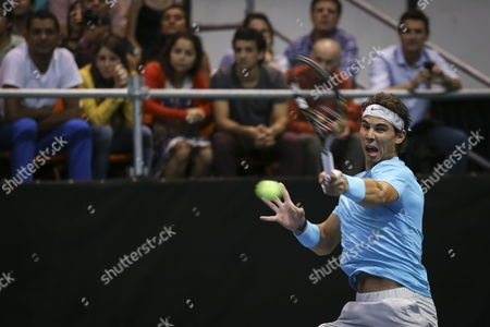 Stock Picture of Spanish Tennis Player Rafael Nadal Returns a Ball to Argentinian David Nalbandian (not Pictured) During an Exhibition Game As Part of the Beggining of Nalbandian's Farewell From Tennis at the Orfeo Stadium in Cordoba Argentina 21 November 2013 Argentina Cordoba