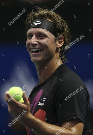 Argentinian David Nalbandian Reacts During a Match Against Spanish Rafael Nadal (not Pictured) As Part of an Exhibition Game For Nalbandian's Farewell From Tennis at the Orfeo Stadium in Cordoba Argentina 21 November 2013 Argentina Cordoba