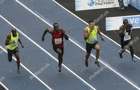 World Champion and Jamaican Athlete Usain Bolt (2-l) Churandy Martina (l) of the Netherlands Usa's Ryan Bailey (2-r) and the Brazil's Jose Carlos Gomes (r) Compete in the Challenge 'Mano a Mano' in Rio De Janeiro Brazil 19 April 2015 Brazil Rio De Janeiro