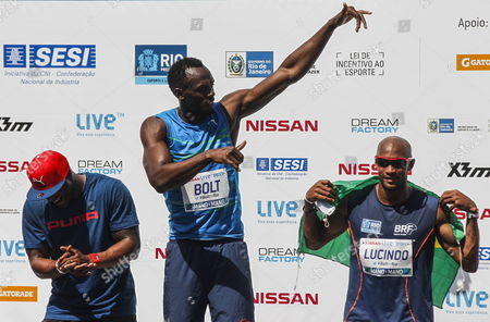 Jamaican Sprinter Usain Bolt (c) Celebrates with British Mark Lewis-francis (l) and Brazilian Jefferson Liberato Lucindo (r) on the Podium After Winning the 100-meter Challenge at Copacabana Beach in Rio De Janeiro Brazil 17 August 2014 Brazil Rio De Janeiro