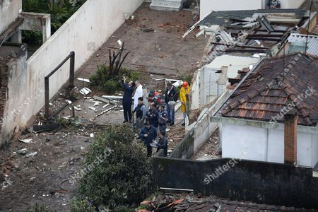 Emergency Responders Inspect the Site where an Aircraft Crashed in the Residential Area Na Rua Vahia De Abreu in Santos Sao Paulo State Brazil 13 August 2014 a Candidate in Brazil's Presidential Election was Killed on 13 August 2014 when a Small Private Plane Crashed in a Residential Area in Santos in the State of Sao Paulo Eduardo Campos 49 was the Candidate of the Brazilian Socialist Party (psb) in the 05 October Election Party Leader Carlos Siqueira Confirmed His Death to Tv Channel Globo Several People Were Reportedly Injured in the Crash Brazilian Aviation Authorities Said the Plane Had Been Carrying Seven People Brazil Santos