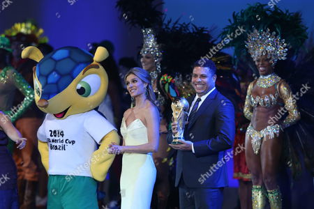 Brazilian Hostess and Model Fernanda Lima (c) Accompanied by Brazilian Former Soccer Player Ronaldo (2-r) Holding a Replica of the Trophy of Fifa World Cup During the Inaugural Ceremony of the 64th Fifa Congress in Sao Paulo Brazil 10 June 2014 Brazil Sao Paulo