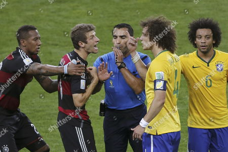 Referee Marco Rodriguez (c) Intervenes Between Germany's Thomas Mueller (2nd L) and Brazil's David Luiz (2nd R) During the Fifa World Cup 2014 Semi Final Match Between Brazil and Germany at the Estadio Mineirao in Belo Horizonte Brazil 08 July 2014 (restrictions Apply: Editorial Use Only not Used in Association with Any Commercial Entity - Images Must not Be Used in Any Form of Alert Service Or Push Service of Any Kind Including Via Mobile Alert Services Downloads to Mobile Devices Or Mms Messaging - Images Must Appear As Still Images and Must not Emulate Match Action Video Footage - No Alteration is Made to and No Text Or Image is Superimposed Over Any Published Image Which: (a) Intentionally Obscures Or Removes a Sponsor Identification Image; Or (b) Adds Or Overlays the Commercial Identification of Any Third Party Which is not Officially Associated with the Fifa World Cup) Brazil Belo Horizonte