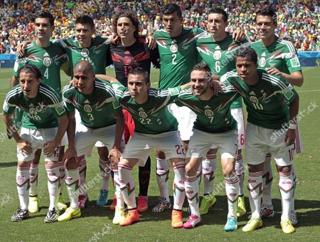 Mexico's Starting Eleven (top L-r) Rafael Marquez Oscar Peralta Goalkeeper Guillermo Ochoa Francisco Maza Rodriguez Hector Herrera Hector Morena (bottom L-r) Andres Guardado Carlos Salcido Paul Aguilar Miguel Layun and Giovani Dos Santos Line Up For the Group Photo Prior the Fifa World Cup 2014 Round of 16 Match Between the Netherlands and Mexico at the Estadio Castelao in Fortaleza Brazil 29 June 2014 (restrictions Apply: Editorial Use Only not Used in Association with Any Commercial Entity - Images Must not Be Used in Any Form of Alert Service Or Push Service of Any Kind Including Via Mobile Alert Services Downloads to Mobile Devices Or Mms Messaging - Images Must Appear As Still Images and Must not Emulate Match Action Video Footage - No Alteration is Made to and No Text Or Image is Superimposed Over Any Published Image Which: (a) Intentionally Obscures Or Removes a Sponsor Identification Image; Or (b) Adds Or Overlays the Commercial Identification of Any Third Party Which is not Officially Associated with the Fifa World Cup) Brazil Fortaleza