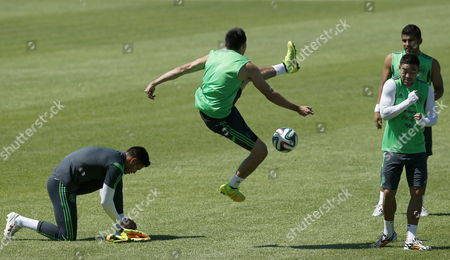 Mexico National Soccer Team Players Hector Herrera (l) Javier Aquino (c) and Miguel Ponce (r) During a Training Session of the Mexican Team in Fortaleza Brazil 28 June 2014 Mexico Will Face Netherlands in the Round of 16 Match on 29 June in a Fifa Soccer World Cup 2014 (restrictions Apply: Editorial Use Only not Used in Association with Any Commercial Entity - Images Must not Be Used in Any Form of Alert Service Or Push Service of Any Kind Including Via Mobile Alert Services Downloads to Mobile Devices Or Mms Messaging - Images Must Appear As Still Images and Must not Emulate Match Action Video Footage - No Alteration is Made to and No Text Or Image is Superimposed Over Any Published Image Which: (a) Intentionally Obscures Or Removes a Sponsor Identification Image; Or (b) Adds Or Overlays the Commercial Identification of Any Third Party Which is not Officially Associated with the Fifa World Cup) Brazil Fortaleza
