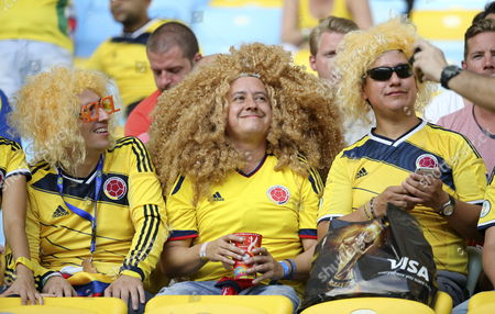 Colombia Supporters Wearing a Carlos Valderrama-style Wig Cheer Prior the Fifa World Cup 2014 Round of 16 Match Between Colombia and Uruguay at the Estadio Do Maracana in Rio De Janeiro Brazil 28 June 2014 (restrictions Apply: Editorial Use Only not Used in Association with Any Commercial Entity - Images Must not Be Used in Any Form of Alert Service Or Push Service of Any Kind Including Via Mobile Alert Services Downloads to Mobile Devices Or Mms Messaging - Images Must Appear As Still Images and Must not Emulate Match Action Video Footage - No Alteration is Made to and No Text Or Image is Superimposed Over Any Published Image Which: (a) Intentionally Obscures Or Removes a Sponsor Identification Image; Or (b) Adds Or Overlays the Commercial Identification of Any Third Party Which is not Officially Associated with the Fifa World Cup) Brazil Rio De Janeiro