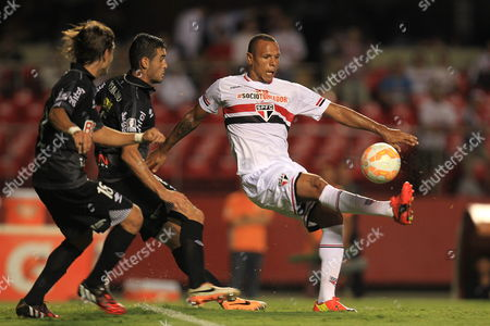 Luis Fabiano (r) of Sao Paulo of Brazil Vies For the Ball with Fabricio Formiliano (l) of Danubio of Uruguay During a Soccer Match As Part of the Libertadores Cup at the Morumbi Stadium in Sao Paulo Brazil 25 February 2015 Brazil Sao Paulo