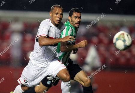 Sao Paulo's Luis Fabiano (l) Vies For the Ball Against Nacional's Francisco Najera (r) During Their Second Leg Semifinals Match of the Sudamerican Cup at Morumbi Stadium in Sao Paulo Brazil 26 November 2014 Brazil Sao Paulo