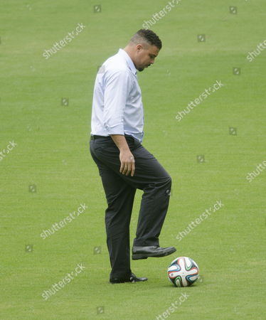 Stock Picture of Brazilian Former Player Ronaldo Luis Nazario De Lima Plays with a 'Brazuca' During a Visit to Arena Pantanal Stadium Now Under Construction in Cuiaba Brazil 23 April 2014 Fifa Secretary General Jerome Valcke Demanded That the Responsibles of This Stadium's Construction Finish the Seat Installment Before 05 May to Be Ready For the Brazil 2014 World Cup Brazil Cuiabß