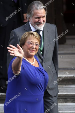 Stock Picture of Elected Chilean President Michelle Bachelet Waves at the Photographers As She Arrives at the Diplomatic Academy For Her Meeting with the German Minister of State at the Federal Foreign Office Maria Bohmer (not Pictured) in Santiago De Chile Chile 10 March 2014 Bohmer is Attending Michelle Bachelet's Investiture Ceremony on 11 March 2014 Chile Santiago De Chile