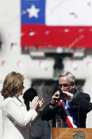 Stock Photo of Chilean President Sebastian Pinera (r) Drinks Chicha a Traditional Beverage Similar to Cider From a Horn Next to His Wife Cecilia Morel (l) at La Moneda Palace During Traditional Celebrations Marking 203 Years of Chilean Independence in Santiago De Chile Chile 18 September 2013 Chile Santiago