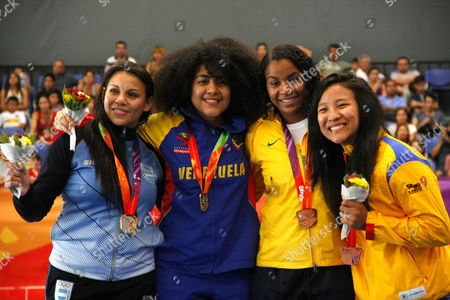 (l-r) Veronica Lugo From Argentina Yeisy Pi±a From Venezuela Isabela Dos Santos From Brazil and Sayaka Osorio From Colombia Pose After the More Than 68 Kg Karate Competition at the Tenth Odesur Games in Santiago Chile 08 March 2014 the Games Will Run From 07 to 18 March 2014 Chile Santiago