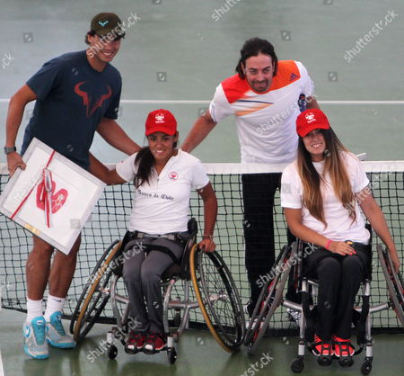Spanish Tennis Player Rafael Nadal (l) and Chilean Tennis Player Nicolas Massu (2-r) Pose For a Picture Next to Players in Wheel Chairs From the Teleton Foundation After a Tennis Clinic in Santiago De Chile Chile 19 November 2013 Spanish Player Rafael Nadal Argentine Player David Nalbandian and Serbian Player Novak Djokovic Are in Chile For the Farewell Event of the Chilean Tennis Player Nicolas Massu Epa/mario Ruiz Chile Santiago De Chile