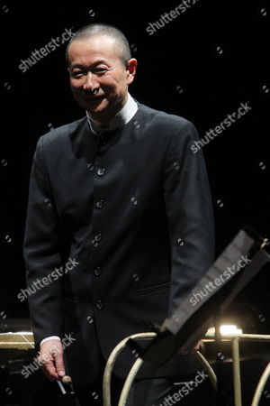Stock Photo of Chinese Orchestra Director and Composer Tan Dun Performs During the Play 'Martial Arts Trilogy' in the International Theatre Festival 'Santiago a Mil' at Constitution Square in Santiago De Chile Chile 04 January 2015 Chile Santiago De Chile