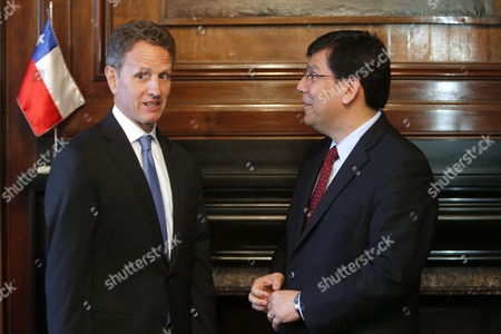Us Former Treasure Secretary Timothy Geithner (l) Meets Chilean Treasure Minister Alberto Arenas (r) at Ministry's Headquarters in Santiago De Chile Chile 24 September 2014 Chile Santiago De Chile