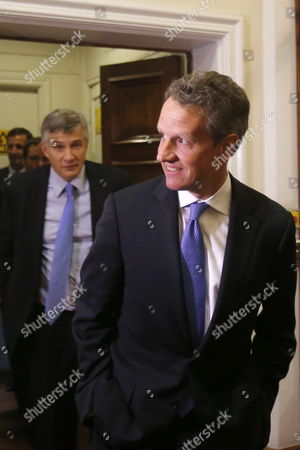 Stock Photo of Us Former Treasure Secretary Timothy Geithner Arrives to Meet Chilean Treasure Minister Alberto Arenas at the Ministry's Headquarters in Santiago De Chile Chile 24 September 2014 Chile Santiago De Chile
