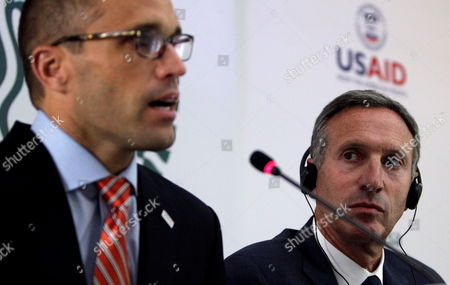 Stock Photo of Executive Director of Starbucks Howard Schultz (r) Listens to Representative of Us Agency For International Development (usaid) Mark Lopez (l) During a Press Conference in Bogota Colombia 26 August 2013 Us Chain Starbucks Announced That They Will Open Their First Stores in Bogota Next Year and Are Also Planning That Colombia Becomes One of Its Mains Suppliers in Latin America Colombia Bogotá