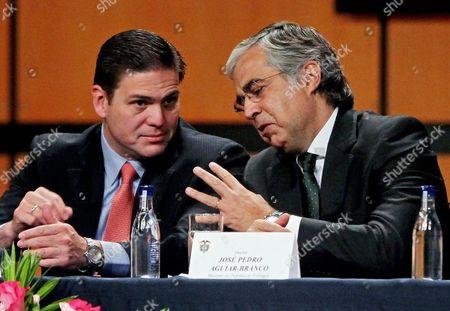 Colombian Minister of Defense Juan Carlos Pinzon (l) Listens to His Portuguese Counterpart Jose Pedro Aguiar-branco (r) at the 4th Expodefense in Bogota Colombia 29 October 2014 Colombia Bogota
