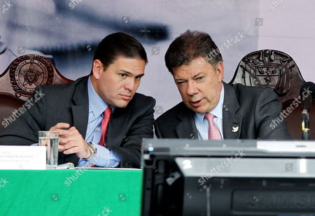 Colombian President Juan Manuel Santos (r) Talks to His Minister of Defense Juan Carlos Pinzon (l) During the Launching of the Christmas Plan of Security of Colombian National Police in Bogota Colombia 01 December 2014 Santos Said He Expects General Ruben Dario Alzate Released on Last 30 November by Farc Presenting the Circumstances of His Kidnapping to the Country Colombia Bogota