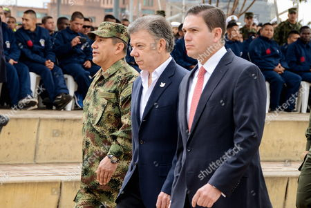 Colombian President Juan Manuel Santos (c) Colombian Minister of Defense Juan Carlos Pinzon (r) and Commader of Armed Forces of Colombia General Juan Pablo Rodriguez (l) Participate in the March For the Peace in Bogota Colombia 09 April 2015 Thousands of Citizens in the Colombian Capital City Called by Leftist Movements Took the Streets to Call For the End of Colombian Armed Conflict Colombia Bogota