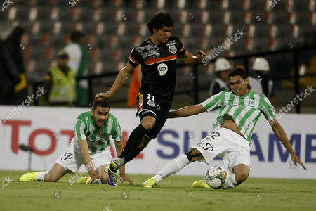 Blas Caceres (c) of Atletico Nacional of Colombia Fights the Ball with Daniel Bocanegra (l) and Francisco Najera (r) of General Diaz of Paraguay During a Match of Sudamericana Cup at Medellin Colombia 10 September 2014 Colombia Medell?n