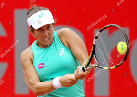 Stock Photo of Irina Falconi of the Usa in Action Against Germany's Dinah Pfizenmaier During Their Second Round Match at the Colsanitas Tennis Open in Bogota Colombia 15 April 2015 Colombia Bogota
