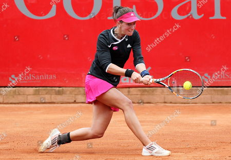 Stock Image of Germany's Dinah Pfizenmaier in Action Against Usa's Irina Falcone During Their Second Round Match at the Colsanitas Tennis Open in Bogota Colombia 15 April 2015 Colombia Bogota