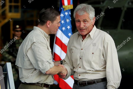 Us Defense Secretary Chuck Hagel (r) and Colombian Defense Minister Juan Carlos Pinzon (l) Shake Hands During a Visit to a Colombian Military Base in Tolemaida Colombia 10 October 2014 the Us Government Through Its Defense Secretary Hagel Has Confirmed Their Support to the Peace Negotiations Between Colombia and the Revolutionary Armed Forces of Colombia (farc) Guerrilla Group in Havana Cuba Colombia Tolemaida
