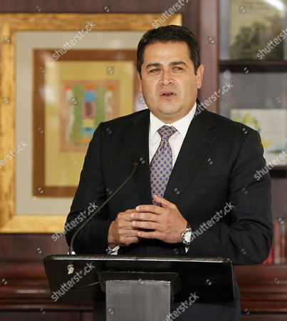 Stock Picture of President-elect of Honduras Juan Orlando Hernßndez Speaks Before the Press Next to Costa Rican Chancellor Enrique Castillo (not in Picture) After a Private Meeting with Costa Rican President Laura Chinchilla in San Jose Costa Rica 04 December 2013 Costa Rica San Jos?