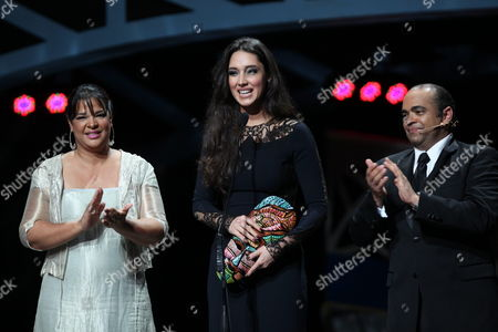 Former Miss Universe and Dominican Amelia Vega (c) Speaks After Receiving an Award During the Opening of the Global Film Festival 2013 in Santoa Domingo Dominican Republic 12 November 2013 Dominican Republic Santo Domingo