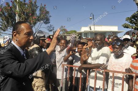 Haitian Politician and Former Dictator Jean-claude Duvalier Known As Baby Doc Waves During Commemoration Acts For 210th Anniversary of Haitian Independence at Gonaives Artibonite Haiti 01 January 2014 Haiti Gonaives