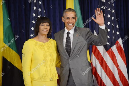 Us President Barack Obama (r) Next to the Primer Minister of Jamaica Portia Simpson-miller (l) Poses For the Press During the First Official Act of Obama's Agenda in Kingston Jamaica 09 April 2015 Obama Made an Official Stop in Jamaica Before Travelling to Panama Jamaica Kingston