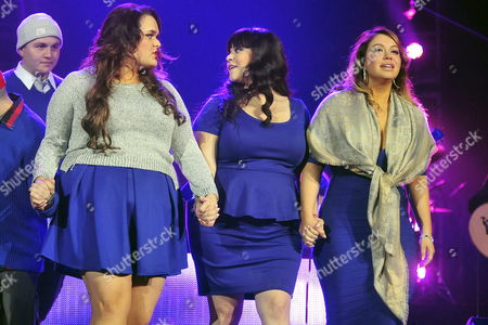 Jenicka (l) Jackie (c) and 'Chiquis' Rivera (r) Sisters of Late Mexican - Us Singer Jenni Rivera Perform During the First Anniversary of Their Sister?s Death at Arena Monterrey in Monterrey Mexico 09 December 2013 Rivera Died on 08 December 2012 in an Airplane Accident in the Mexican Municipality of Iturbide in the State of Nuevo Leon After Performing in a Concert at Arena Monterrey Mexico Monterrey